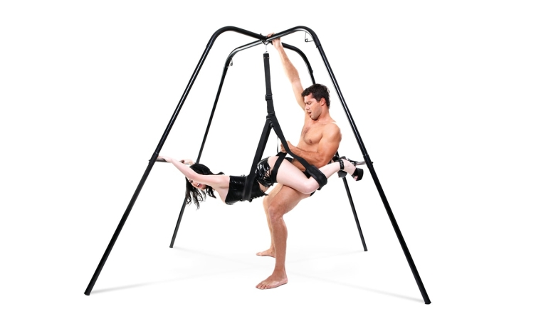 Man having sex with woman from behind on the Pipedreams Fetish Fantasy Swing Stand