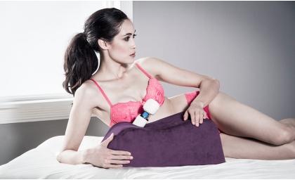 Woman lying next to Wanda Sex Toy Mount 1
