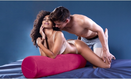 Woman and man in doggy style sex position on the Whirl Sex Pillow 1